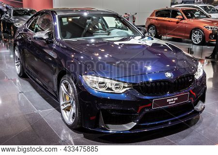 Bmw M4 Coupe Car Showcased At The Brussels Expo Autosalon Motor Show. Belgium - January 12, 2016