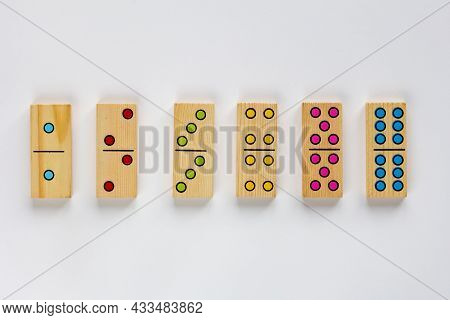 Top View Of Wooden Six Dominoes Gaming Pieces With Double Spots On It On The White Background