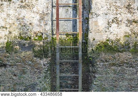 Rusty Iron Staircase And Dirty Concrete Wall