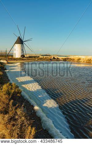 Old Historic Windmill In Salt Marshes At San Pedro Del Pinatar Park, Murcia Spain. Tourist Attractio