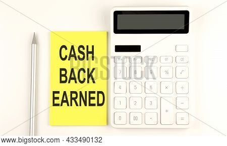 Text Cash Back Earned On Yellow Sticker, Next To Pen And Calculator