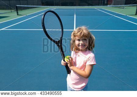 Child Boy Tennis Beginner Player On Outdoor Tennis Court.