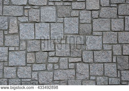 Irregular Cyclopean Masonry On The Wall Of A House Or Cottage. Gray Granite Is Cut Into Cube Shapes