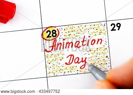 Woman Fingers With Pen Writing Reminder Animation Day In Calendar. October 28