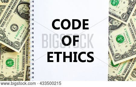Code Of Ethics Symbol. Words 'code Of Ethics' On White Note. Beautiful Background From Dollar Bills.