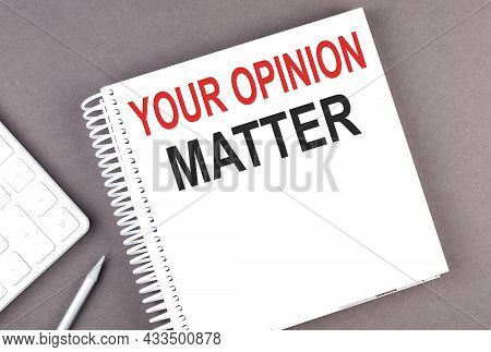 Your Opinion Matter Text On The Notebook With Calculator And Pen
