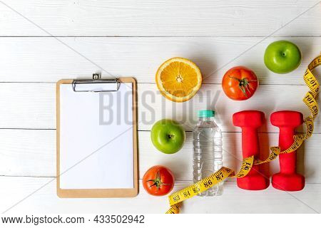 Planning For Diet Health Eat And Food.  Sport Exercise Equipment Workout With Fresh Fruit, Measuring