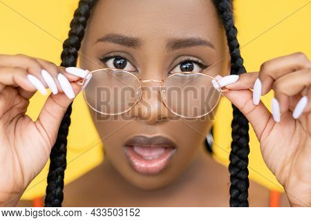 Astonished Woman. Omg Expression. Vision Correction. Shocked Afro Model Open Mouth Face In Spectacle