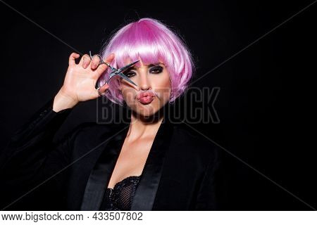 Woman With Scissors Having Hair Cut Isolated On Black. Beautiful Girl With Straight Hair With Profes