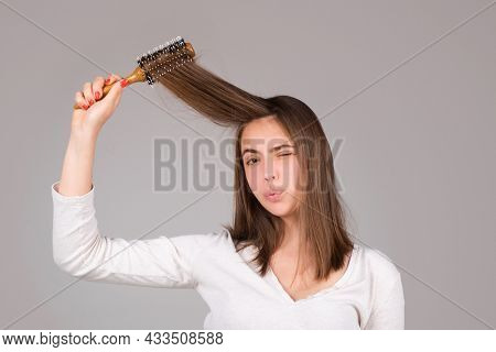 Funny Woman Brushing Straight Natural Hair With Comb. Girl Combing Long Healthy Hair With Hairbrush.