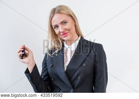 Woman Manager In Business Clothes Is Holding The Keys To Car And Smiling While Looking At The Camera