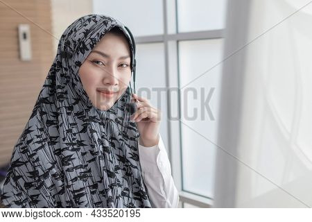 Customer Support. Happy Arab Female Call Center Customer Support Executive With Headset Working In O