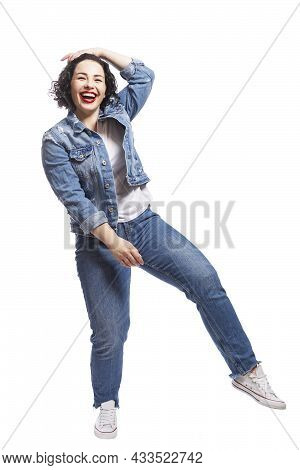 Young Dancing Plump Girl. Beautiful Curly Brunette With Red Lips In Jeans. Body Positivity And Freed