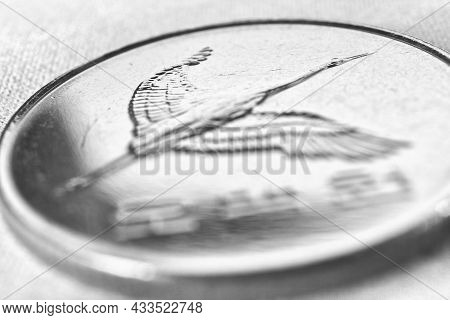 Translation: 500 Won. Korean Coin Close Up. Obverse With The Image Of A Crane. Light Black And White