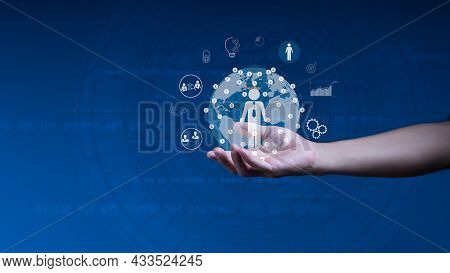 Businessman Holds A World Map Circle And Network Structure Hr - Human Resources. The Concept Is Busi