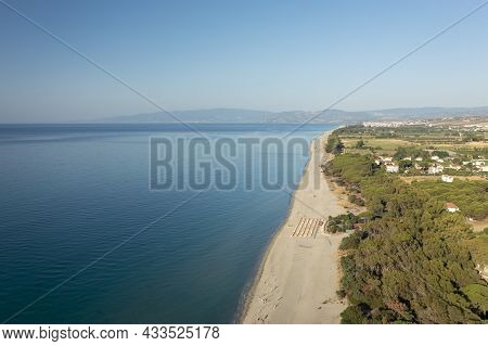 Drone Shot Of Beautiful Sea And Beach With Parasol At Sunny Day, Simeri Mare, Calabria, Southern Ita