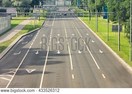 Arrow Signs As Road Markings On A Street With Five Lanes. Dedicated Lane For Public Transport, Buses