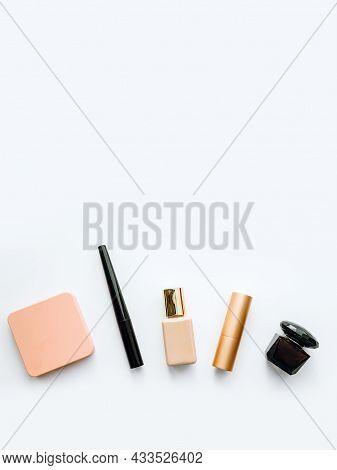 Decorative Cosmetics On A White Background: Powder, Eyeliner, Foundation, Lipstick And Perfume