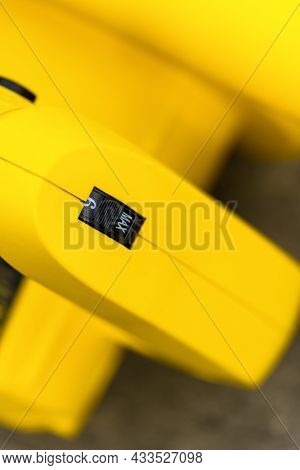 Close Up Of Speed Switch Button On Yellow Instrument, Button Maximum, Vertical Photography