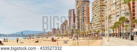 Beach Of Benidorm At Sunny Summer Day, City Skyline Horizontal Background. Modern Skyscrapers Seasid