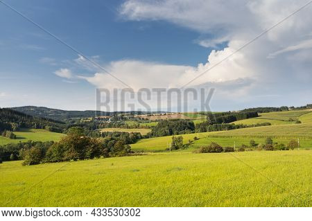 Summer Landscape With Green Meadows, Pastures And Trees Under Blue Sky. Czech Republic, Europe.