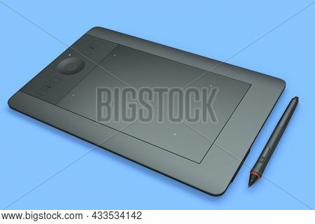 Graphic Tablet And Pen For Illustrators, Designers And Photographers On Blue