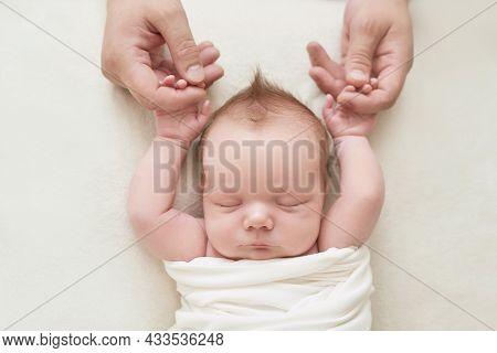 Newborn Baby Boy In Daddy\'s Hands Sleeping On White Background. Medicine And Health Concept, Happy
