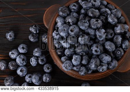 Blueberries In A Bowl On A Wooden Background. Top View.