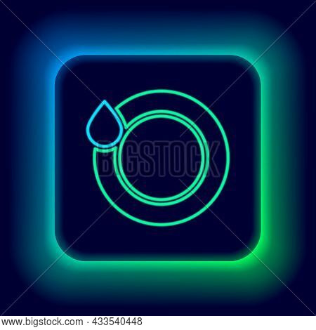 Glowing Neon Line Washing Dishes Icon Isolated On Black Background. Plate And Sponge. Cleaning Dishe