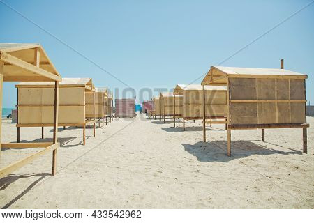 Houses On The Beach Of Caspian Sea . Summer Background . The Seaside . Wooden Houses By The Beach In