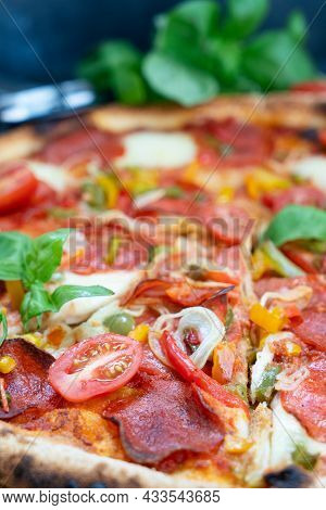 Pizza With Salami And Tomatoes Close Up View