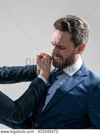 Professional Man Employee Got Punch In Face With Fist Grey Background, Conflict