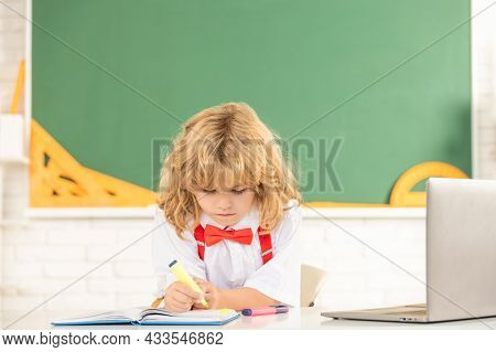 Concentrated Teen Boy In Classroom. Back To School. Knowledge Day. Concept Of Education.