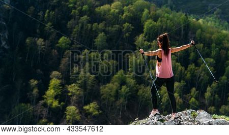The Traveler Is Happy To Climb The Mountain, Panorama. A Girl Meets The Sunset In The Mountains. Mou
