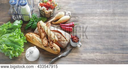 An Assortment Of Different Types Of Bread. Italian Ciabatta Bread, Grissini With Tomatoes, Milk And