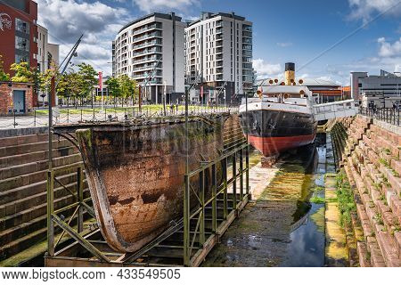 Belfast, Uk, Aug 2019 Part Of A Ship Wreck And Ss Nomadic, The Last Remaining White Star Line Ship I