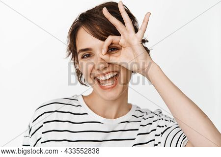 Close Up Portrait Of Smiling Happy Woman Showing Ok, Okay Sign And Looking Satisfied, Recommending S