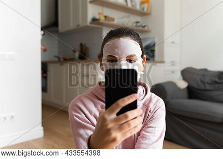 Young Woman With Beauty Mask At Home. Snackable Wellness Concept. Relaxation At Home For Young Mothe