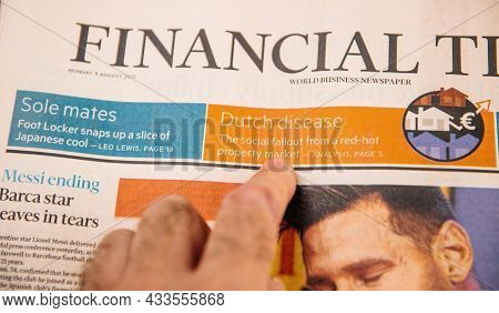 Paris, France - Aug 12, 2021: Male Hand Reading In The Kitchen Early In The Morning Financial Times