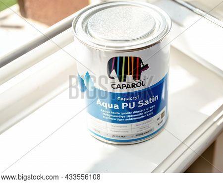 Paris, France - Sep 8, 2021: View Near The Window New Unopened Metal Can With Caparol Aqua Pu Satin