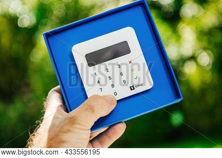 Paris, France - Sep 8, 2021: Unboxing Of New Sumup Emv Card Reader Which Can Read Magnetic Strip, Ch