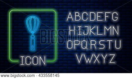 Glowing Neon Kitchen Whisk Icon Isolated On Brick Wall Background. Cooking Utensil, Egg Beater. Cutl