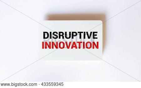 Business Concept.text Disruptive Innovation Writing On Wooden Puzzle On A Yellow Background
