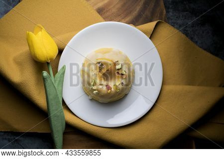 Lemon Pound Cake Served For Dessert On White Plate In Dark Background. This Cake Made From Lemon Jui