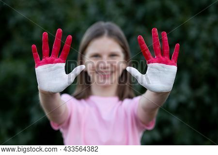 Child Girl Show Hands Painted In Indonesia And Monaco Flag Colors, Focus On Hands. Indonesian Patrio