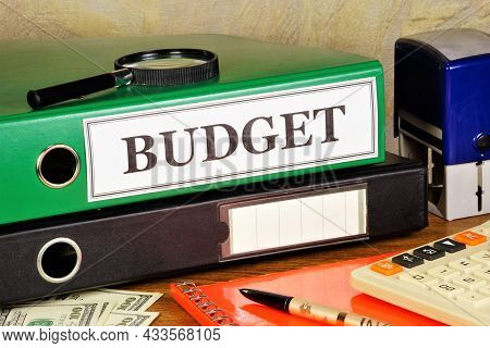 Budget. The Inscription On The Folder Of The Office Registrar, Against The Background Of A Calculato