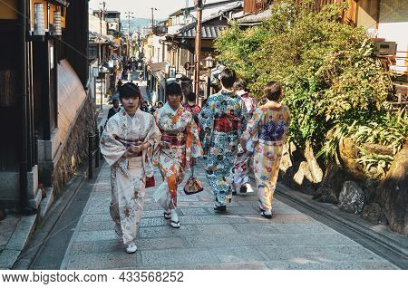 People Wearing Kimono Walking At Old Town