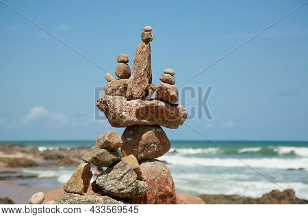 Stones Piled On The Edge Of The Beach
