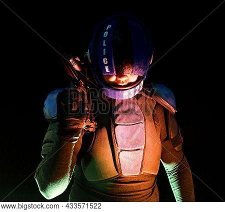 Cyberpunk Concept, Future World. Police Officer Cop In Dark, Halfman Bionic Cyborg Or Reloads Gun, T