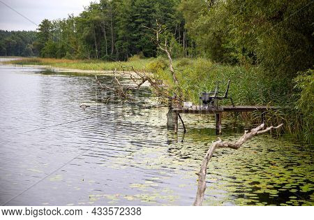 A Bridge On The Lake For Fishing, Fishing Rods And Bait. Beautiful Nature, Writhing In The Water, Fi